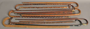 Group of 13 canes to include a sword cane and a flask cane