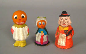 Three composition Halloween candy containers early 20th c
