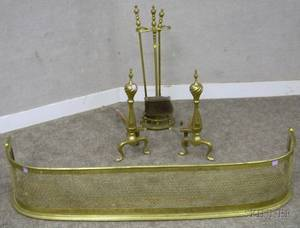 Pair of Brass Spiretop Andirons a Pierced Brass Fireplace Fender and a Stand with Three Tools