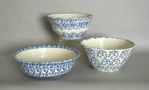 Three blue sponge bowls
