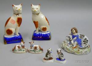 Pair of Staffordshire Seated Cats a Sleeping Girl with Dog Figural Group and Two Pairs of Porcelain Dogs