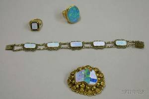 Two 14kt Gold and Opal Rings a Sterling Silver and Opal Bracelet and a Gilt Sterling Silver and Opal Brooch