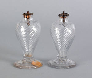 Pair of blown colorless glass sparking lamps 19th c