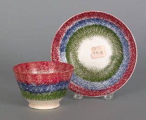 Red blue and green rainbow spatter cup and saucer 19th c