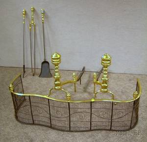 Pair of Brass Andirons a Brass and Wire Serpentine Fender Hearth Shovel and Tongs Set and a Poker
