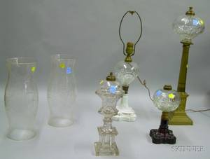Four Glass Oil Table Lamps and a Pair of Colorless Etched Glass Hurricane Shades