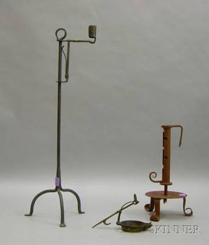 Brass Betty Lamp a Redpainted Wrought Iron Adjustable Footed Candleholder and a Wrought Iron Adjustable Cand