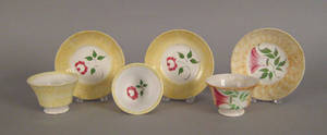 Two yellow spatter cups and saucers 19th c