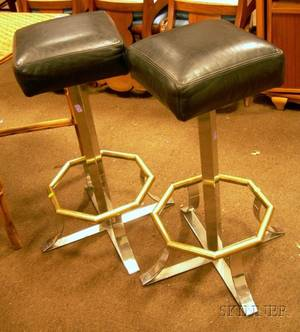 Pair of Black Leather Upholstered Steel and Brass Swivel Stools