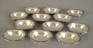 Set of twelve Gorham sterling silver salts with Greek key borders