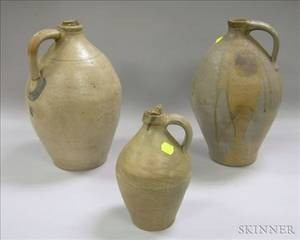Three Ovoid Stoneware Jugs and a Cobalt Highlighted Stoneware Churn