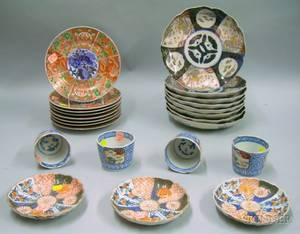 Set of Eight Imari Porcelain Plates Three Small Dishes a Set of Six Cups and a Set of Eight Kutani Porcelain Plates