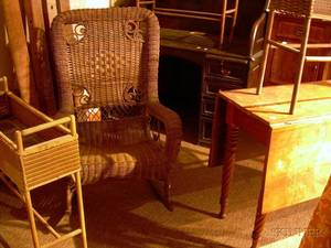 Classical Cherry Dropleaf Table a Late Victorian Roll Top Desk and a Victorian Wicker Armrocker and Three Wo