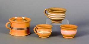 Three small yelloware cups 19th c