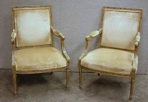 Pair of Louis XVI Style Upholstered Carved and Painted Bergere