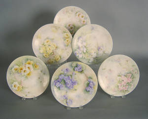 Set of six Limoges plates with floral decoration