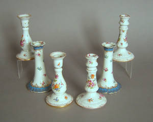Two pair of Dresden porcelain candlesticks
