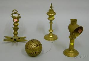 Three Brass Lighting Devices and a Pierced Brass Chafing Ball