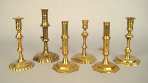 Pair of brass push up candlesticks 18th c