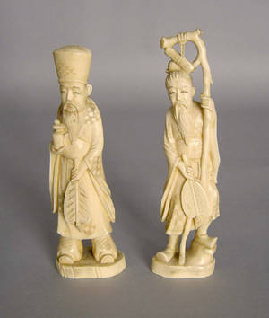 Two oriental carved ivory figures