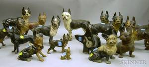 Collection of Thirteen Painted Cast Iron Boston Terrier Doorstops a Paperweight and a Folk Painted Wooden Bos