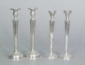 Two pair of sterling silver weighted candlesticks