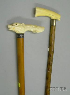 Carved Ivoryhandled Walking Stick and a Carved Ivory Boars Head and Hoof Handle Riding Crop