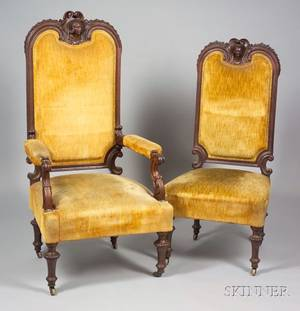 Pair of Victorian Renaissance Revival Upholstered Carved Walnut Parlor Chairs with Mask Crests
