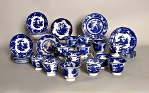 Thirteen flow blue Chusan pattern cups and saucers