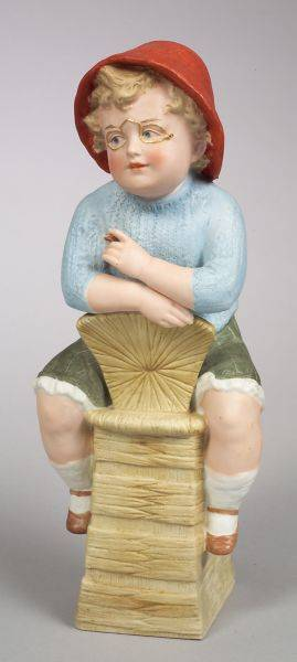 Heubach Bisque Figure of a Seated Boy Holding a Cigar