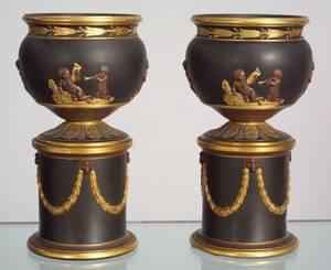 Pair of Wedgwood Gilded and Bronzed Black Basalt Urns