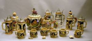 Ten German Polychrome Stoneware and Porcelain Steins and a Sevenpiece German Polychrome Decorated Stoneware P
