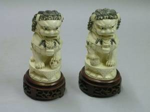 Pair of Asian Carved Ivory Foo Dogs