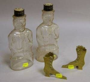 Two Colorless Molded Glass Figural Lincoln Bank Bottles and a Pair of Miniature Brass High Button Shoeform Flo