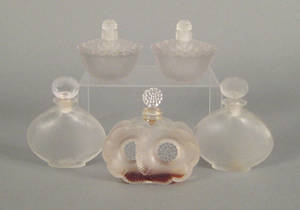 Pair of Lalique molded glass perfume bottles ca 1930