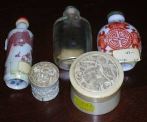 Three Asian Glass and Porcelain Snuff Bottles and Two Small Chinese Carved Ivory Boxes