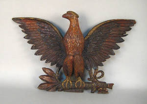 Carved and painted spread winged eagle wall plaque late 19th c