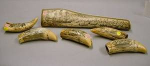 Five Reproduction Scrimshaw Resin Whale Teeth and a Panbone