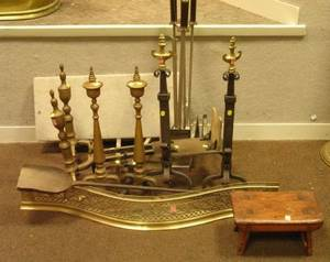 Two Pairs of Brass Urntop Andirons a Brass Serpentine Openwork Fireplace Fender a Wrought Iron Hearth Shovel