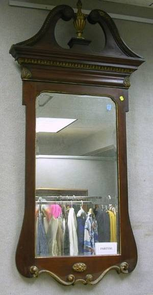 George III Style Mahogany and Carved Giltwood Mirror and an Oval Gilt Mirror
