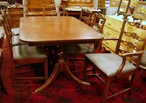 Set of Eight Chippendalestyle Carved Mahogany Ribbonback Dining Chairs and a DoublePedestal Dining Table
