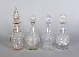 Four colorless blown glass decanters 19th c