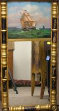 Giltwood and Ebonized SplitBaluster Mirror with ReversePainted Glass Sailing Ship Tablet