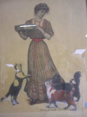 Framed Mixed Media Work of a Woman Feeding Cats