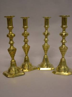 Pair and Near Pair of Brass Beehive Candlesticks