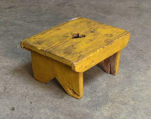 Yellow painted foot stool with heart cutout