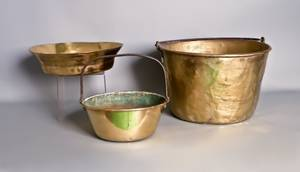 Two brass buckets together with a milk pan