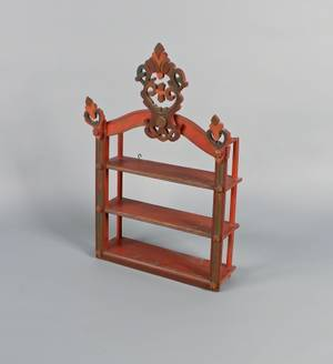 Carved and painted hanging shelf
