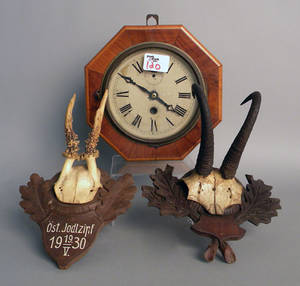 Pair of Black Forest trophy mounts with carved mahogany backs