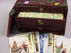 Small Group of European Postcards and a Chinese Hardwood Cased Ivory Mahjong Set